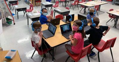 students in school wearing masks